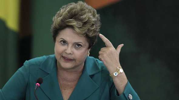 "Rousseff's chief of staff said the president was ""perplexed and saddened"" by the committee vote [AP]"